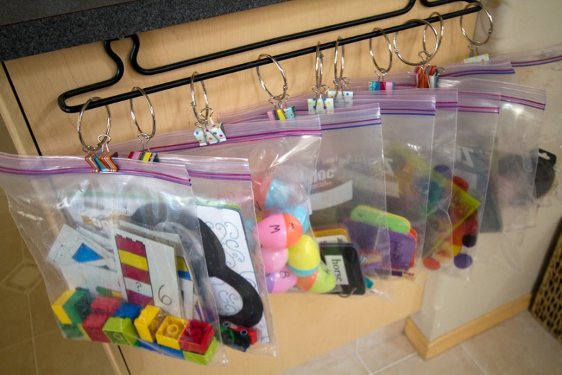 6c12a6aeca I use binder rings and big clips and a towel rack. They bags are off my  floor and easily accessible and visible to the children when they want to  play.